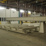 K&M Machine Fabricating - Fabricated, Machined, Assembled Base and Gantry for CNC Router for Aerospace Industry